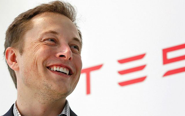 Tesla CEO Elon Musk, seen above thinking about all sorts of boobs. - (AP Photo)
